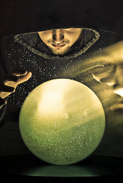 man looking into crystal ball