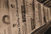 newspapers showing headlines