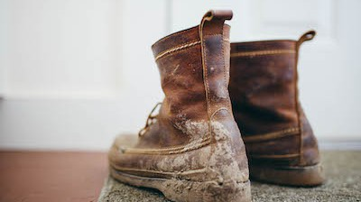 a pair of work boots with mud on them