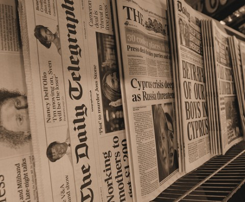 newspaper stand showing headlines and titles