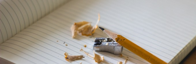 photo of writer's block with pencil, paper, sharpener